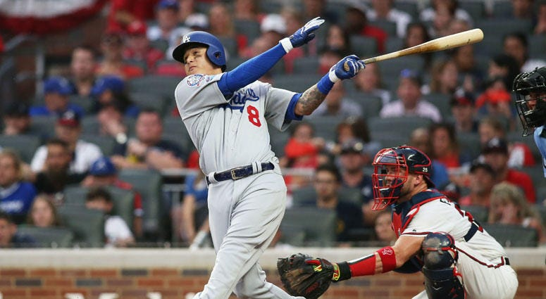 Dodgers shortstop Manny Machado hits a three-run home run in the seventh inning in Game 4 of the National League Division Series at SunTrust Park in Atlanta.