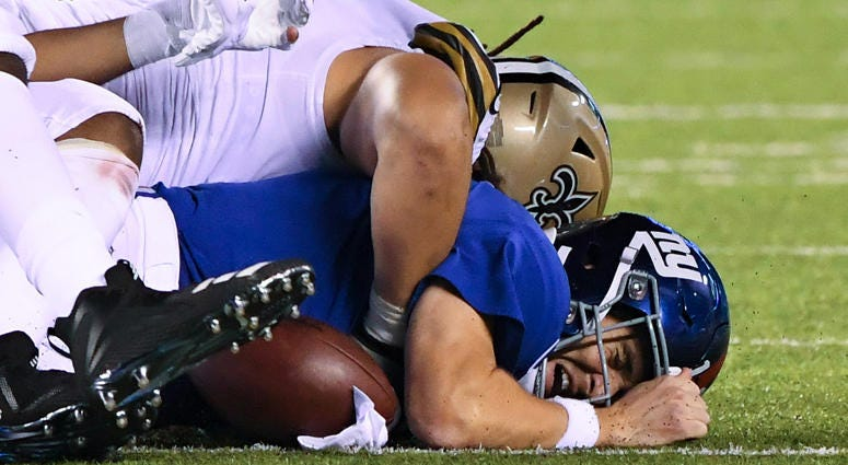 Giants quarterback Eli Manning fumbles the ball against the Saints late in the fourth quarter on Sept. 30, 2018, at MetLife Stadium.