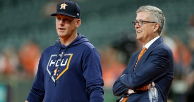 Manager AJ Hinch talks with Jeff Luhnow, General Manager of the Houston Astros, prior to game two of the American League Division Series against the Tampa Bay Rays at Minute Maid Park on October 05, 2019 in Houston, Texas.