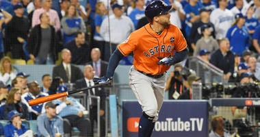 Astros center fielder George Springer hits a two-run home run against the Dodgers in Game 7 of the 2017 World Series.