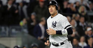 Aaron Judge of the Yankees comes home to score a run on a walk against the Houston Astros during the first inningin game four of the American League Championship Series at Yankee Stadium on October 17, 2019 in New York City.