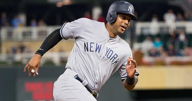 Sep 10, 2018; Minneapolis, MN, USA; New York Yankees outfielder Aaron Hicks (31) rounds third in the seventh inning against Minnesota Twins at Target Field. Mandatory Credit: Brad Rempel-USA TODAY Sports
