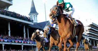 Nov 3, 2018; Louisville, KY, USA; Jockey Joel Rosario aboard Accelerate (14) wins the Breeders Cup Classic during the 35th Breeders Cup world championships at Churchill Downs. Mandatory Credit: Brian Spurlock-USA TODAY Sports