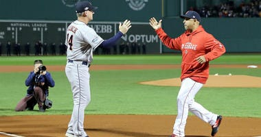 AJ Hinch of the Astros and Alex Cora of the Red Sox shake hands prior to Game One of the American League Championship Series at Fenway Park on October 13, 2018 in Boston, Massachusetts.