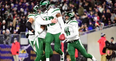 Jets linebacker B.J. Bello celebrates after scoring a touchdown on a blocked punt in the fourth quarter against the Ravens on Dec. 12, 2019, at M&T Bank Stadium in Baltimore.