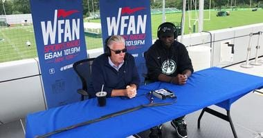 Jets coach Todd Bowles talks with Mike Francesa at training camp in Florham Park, New Jersey, on Aug. 21, 2018.