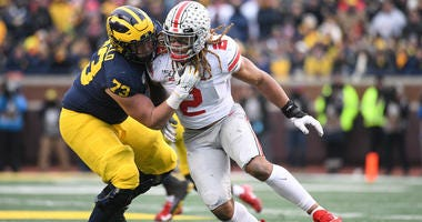 Ohio State defensive end Chase Young looks to get around Michigan offensive lineman Jalen Mayfield on Nov. 30, 2019 in Ann Arbor, Michigan.