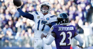 Jan 6, 2019; Los Angeles Chargers quarterback Philip Rivers passes the ball as Baltimore Ravens strong safety Tony Jefferson defends in the second quarter in a AFC Wild Card playoff game at M&T Bank Stadium. Mandatory Credit: Geoff Burke-USA TODAY Sports