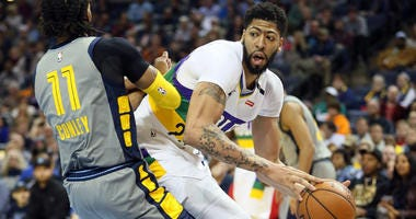 Pelicans forward Anthony Davis looks to pass as Grizzlies guard Mike Conley defends on Feb. 9, 2019, in Memphis.