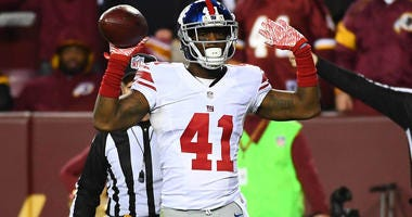 Jan 1, 2017; Landover, MD, USA; New York Giants cornerback Dominique Rodgers-Cromartie (41) celebrates after intercepting a pass against the Washington Redskins during the second half at FedEx Field. Mandatory Credit: Brad Mills-USA TODAY Sports
