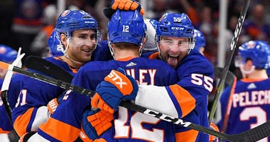 Islanders defenseman Johnny Boychuk (55) celebrates after the game with right wing Josh Bailey (12) and center Valtteri Filppula (51) in the gam against the Pittsburgh Penguins in game one of the first round of the 2019 Stanley Cup Playoffs at Barclays Ce