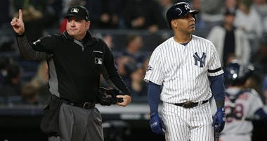 The Yankees' Edwin Encarnacion walks back to the dugout after arguing with home plate umpire Dan Bellino following a strikeout in Game 4 of the ALCS on Oct. 17, 2019, at Yankee Stadium.