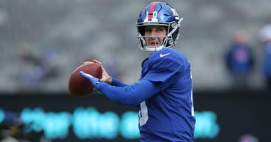 New York Giants quarterback Eli Manning (10) warms up before a game against the Miami Dolphins at MetLife Stadium