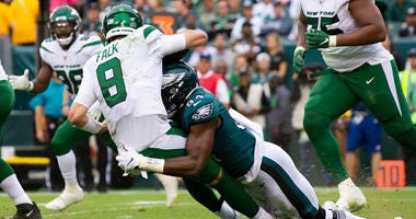 Eagles defensive end Josh Sweat sacks Jets quarterback Luke Falk on Oct. 6, 2019, in Philadelphia.