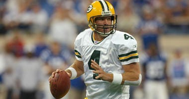 Green Bay Packers quarterback Brett Favre looks for an open receiver against the Indianapolis Colts on Sept. 26, 2004, at the RCA Dome in Indianapolis.
