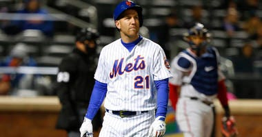 The Mets' Todd Frazier walks to the dugout after striking out in the fourth inning against the Washington Nationals on April 17, 2018, at Citi Field.
