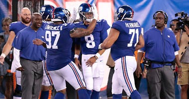 Giants quarterback Daniel Jones (8) celebrates after throwing a touchdown pass against the Jets on Aug. 8, 2019, at MetLife Stadium.