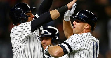 Apr 17, 2019; Bronx, NY, USA; New York Yankees left fielder Brett Gardner (11) celebrates his grand slam home run with Yankees center fielder Mike Tauchman (39) against the Boston Red Sox. Mandatory Credit: Adam Hunger-USA TODAY Sports