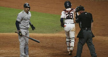 Oct 13, 2019; Houston, TX, USA; New York Yankees catcher Gary Sanchez (24) reacts after being called out on strikes to end the 11th inning in game two of the 2019 ALCS playoff baseball series against the Houston Astros at Minute Maid Park.
