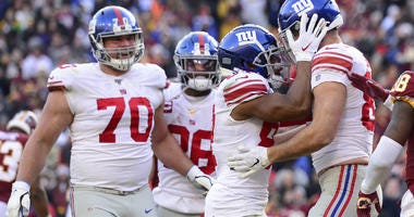 Kaden Smith of the Giants celebrates with teammates after scoring a touchdown in the second half against the Washington Redskins at FedExField on December 22, 2019 in Landover, Maryland.