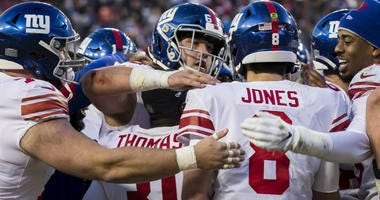 Daniel Jones of the Giants celebrates with teammates after throwing the game winning touchdown against the Washington Redskins during overtime at FedExField on December 22, 2019 in Landover, Maryland.
