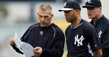 Feb 25, 2015; Tampa, FL, USA; New York Yankees manager Joe Girardi (28) speaks with Mariano Rivera during morning workouts at George M. Steinbrenner Field. Mandatory Credit: Tommy Gilligan-USA TODAY Sports
