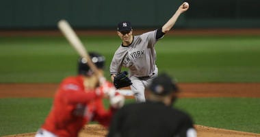 ankees starting pitcher J.A. Happ (34) throws the ball during the first inning against the Boston Red Sox in game one of the ALDS at Fenway Park.