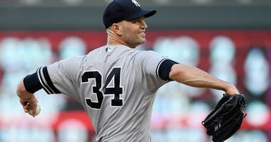 J.A. Happ of the Yankees delivers a pitch against the Twins on July 24, 2019, at Target Field in Minneapolis, Minnesota.
