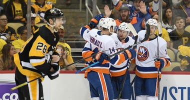 The Islanders' Brock Nelson (second from right) celebrates with teammates after scoring a goal in Game 4 of an Eastern Conference first-round playoff series against the Penguins on April 16, 2019, at PPG Paints Arena in Pittsburgh.