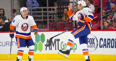 Islanders defenseman Johnny Boychuk celebrates his second-period goal against the Carolina Hurricanes in Raleigh, North Carolina.