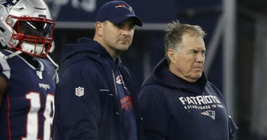 Joe Judge stands with Patriots head coach Bill Belichick before their playoff game against the Tennessee Titans at Gillette Stadium on January 4, 2020.
