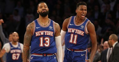 Marcus Morris and Frank Ntilikina of the Knicks