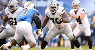 Raiders offensive guard Kelechi Osemele (70) blocks Chargers defensive tackle Damion Square on Dec. 18, 2016, at Qualcomm Stadium in San Diego.