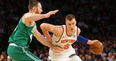 Knicks power forward Kristaps Porzingis drives against Celtics center Aron Baynes on Dec. 22, 2017, at Madison Square Garden.