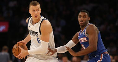 Mavericks power forward Kristaps Porzingis controls the ball against Knicks shooting guard RJ Barrett on Nov. 14, 2019, at Madison Square Garden.