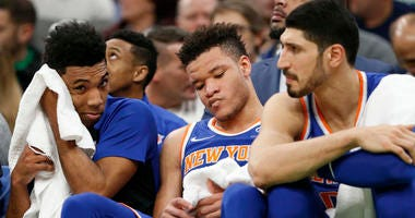 Dec 6, 2018; Boston, MA, USA; Knicks guard Allonzo Trier (14), forward Kevin Knox (20) and center Enes Kanter (0) react on the bench late in the second half against the Boston Celtics at TD Garden. Mandatory Credit: Greg M. Cooper-USA TODAY Sports