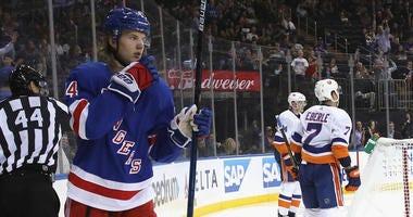 Vitali Kravtsov #74 of the New York Rangers (L) scores a second period goal against Thomas Greiss #1 of the New York Islanders at Madison Square Garden on September 24, 2019 in New York City.