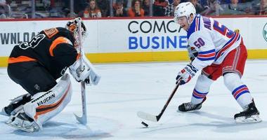 Lias Andersson of the Rangers goes one on one against Calvin Pickard of the Philadelphia Flyers at Wells Fargo Center on November 23, 2018 in Philadelphia, Pennsylvania.