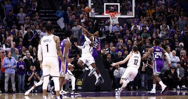 Rondae Hollis-Jefferson of the Brooklyn Nets makes the game-winning shot while guarded by Marvin Bagley III of the Sacramento Kings with two seconds left in the game at Golden 1 Center on March 19, 2019 in Sacramento, California.