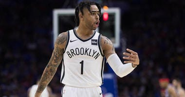 The Nets' D'Angelo Russell reacts to his bench during a break in the second quarter against the 76ers in Game 1 of their first-round playoff game at Wells Fargo Center in Philadelphia.