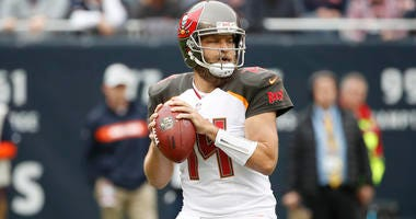 Sep 30, 2018; Chicago, IL, USA; Tampa Bay Buccaneers quarterback Ryan Fitzpatrick (14) looks to pass the ball against the Chicago Bears during the first half at Soldier Field. Mandatory Credit: Kamil Krzaczynski-USA TODAY Sports
