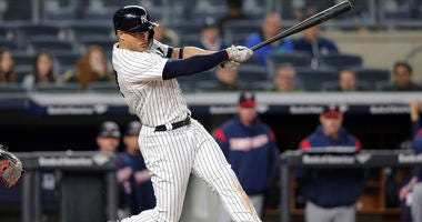 The Yankees' Giancarlo Stanton hits an RBI single against the Minnesota Twins on April 23, 2018, at Yankee Stadium.