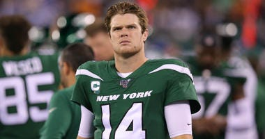 Oct 21, 2019; East Rutherford, NJ, USA; New York Jets quarterback Sam Darnold (14) reacts on the sideline during the fourth quarter against the New England Patriots at MetLife Stadium.