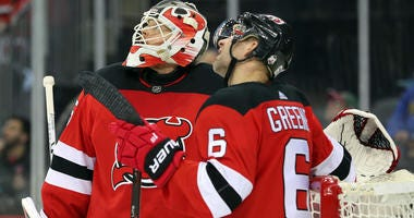 Dec 29, 2017; Newark, NJ, USA; Devils goaltender Cory Schneider (35) and New Jersey Devils defenseman Andy Greene (6) watch a replay during the third period of their game against the Buffalo Sabres. Mandatory Credit: Ed Mulholland-USA TODAY Sports