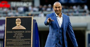 New York Yankees shortstop Derek Jeter waves to the crowd after being honored during a pre-game ceremony to retire his jersey number and unveil his plaque for monument park before the game against the Houston Astros on May 14, 2017 at Yankee Stadium.