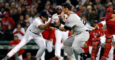 New York Yankees first baseman Tyler Austin starts a scrum with Boston Red Sox relief pitcher Joe Kelly during the seventh inning at Fenway Park.