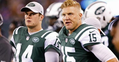 Sam Darnold and Josh McCown watch second half of play against the New York Giants at MetLife Stadium.