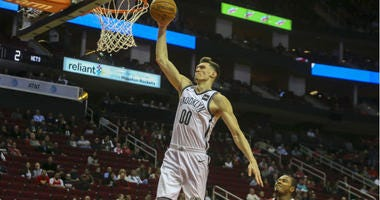 Rodions Kurucs goes up for a dunk during the first quarter against the Houston Rockets at Toyota Center.