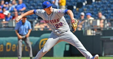 New York Mets relief pitcher Brad Brach (29) delivers a pitch during the eighth inning against the Kansas City Royals