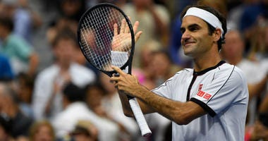 Roger Federer of Switzerland reacts after defeating Damir Dzumhur of Bosnia